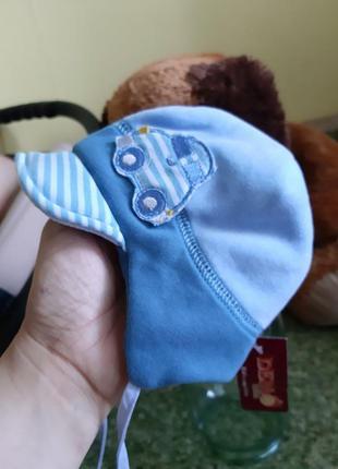 Демисезонная шапочка дембохаус