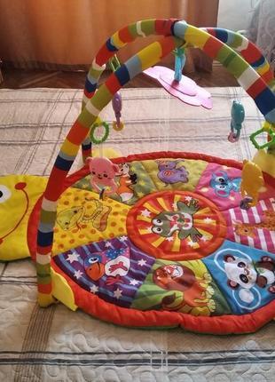 Яркий развивающий коврик для малышей