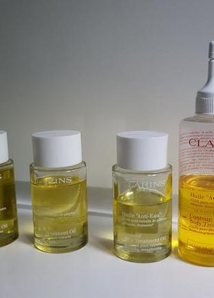 Косметические масла в ассортименте от clarins body treatment oil