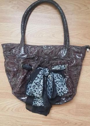 Женская сумка под рептилию derby