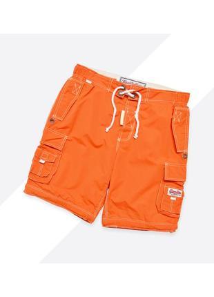 Superdry m / яркие оранжевые шорты с карманами и большим принтом сзади