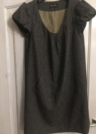 Костюмное платье с карманами