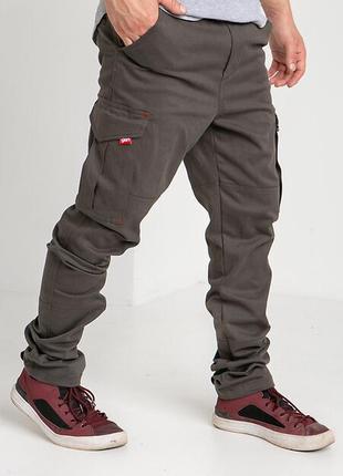 Котонові штани карго захисного кольору з великими кишенями