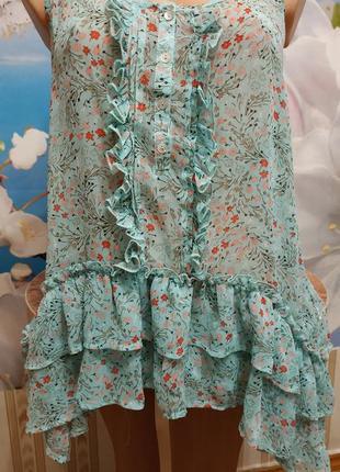 Блуза  шифоновая лёгкая нежной расцветки.