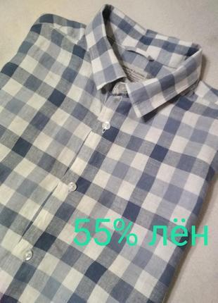 Льняная рубашка в клетку с коротким рукавом.