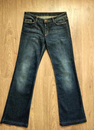 Темно-синие джинсы in wear, с легким клешем