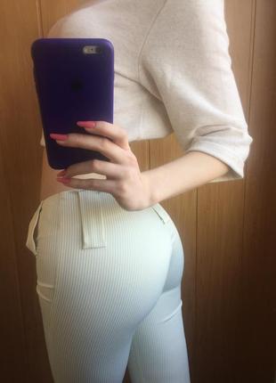 Белые в зелёную полоску брюки. размер s-m.fi more.