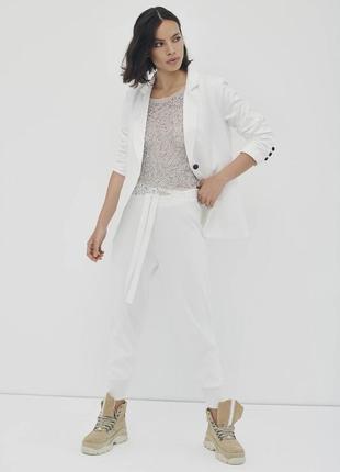Белые брюки в стиле спорт шик nu denmark