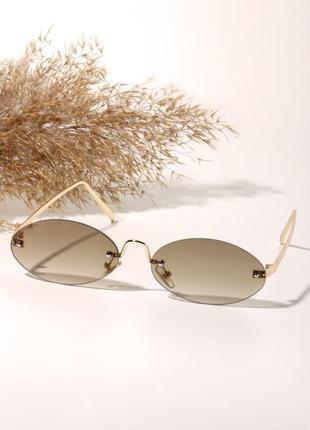 Узкие овальные солнцезащитные очки