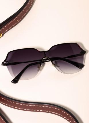 Солнцезащитные очки с двухцветными линзами