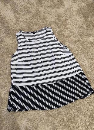 Блузка без рукавів
