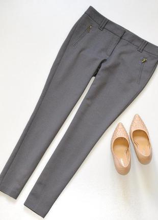 Стильные и практичные брюки серого цвета,укороченные поо фасону