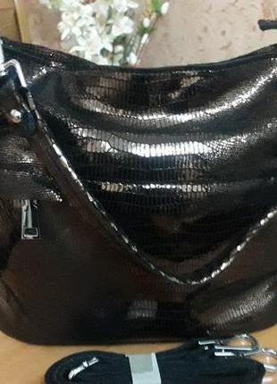 Шкіряна сумка лазерна.