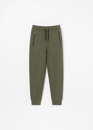 Зеленые штаны из текстурированого трикотажа