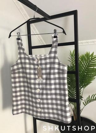 Майка блузка на пуговицах в серо-белую клетку mango