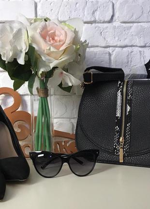 Неординарная сумка кросс-боди с комбинацией блестящей и зернистой фактуры    falth