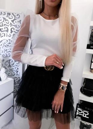 Стильная блуза с объемными рукавами