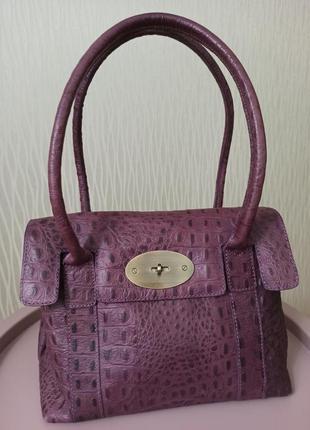 Красивая стильная кожаная сумка