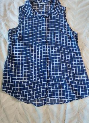 Красивая блузка без рукавов в клетку next