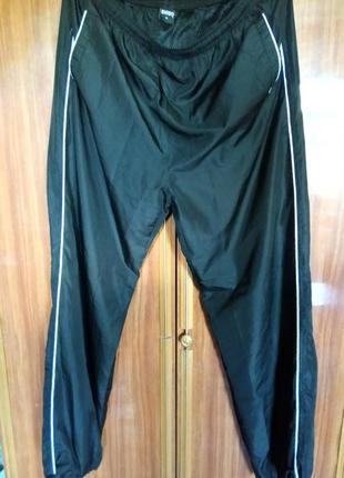 Спортивные новые штаны на сетке,размер l-xxl.