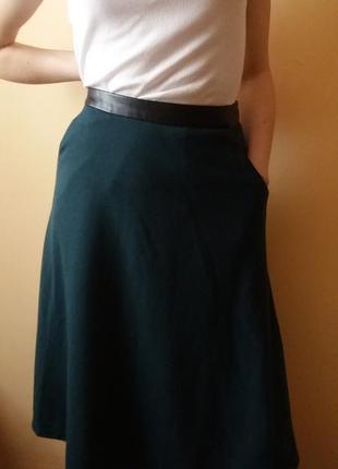 Юбка миди с карманами.