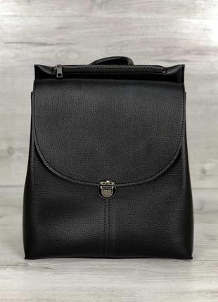 Молодежный сумка-рюкзак в черном цвете, изготовлен из искусственной кожи высокого качества