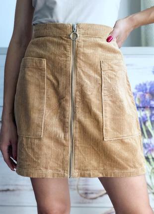 Светло бежевая юбка с кольцом