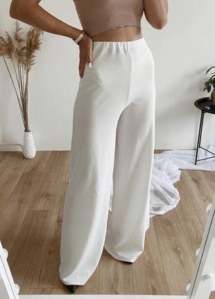 Трендовые белые брюки клёш, трубы
