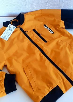 Куртка-бомбер  на теплую осень. reserved польша.