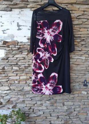 Красивое с драппировкой сбоку и прозрачными рукавами и горловиной  на подкладке платье