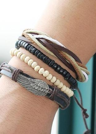 Крутой набор браслетов с крылом в стиле бохо еко кожа бичевка перо крылья браслет