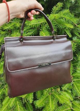 Жіноча шкіряна двохстороння сумка.