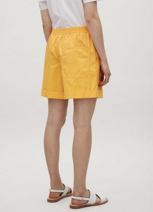Хлопковые желтые яркие шорты cos