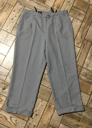 Стильные укороченные брюки с манжетами в гусиную лапку canda