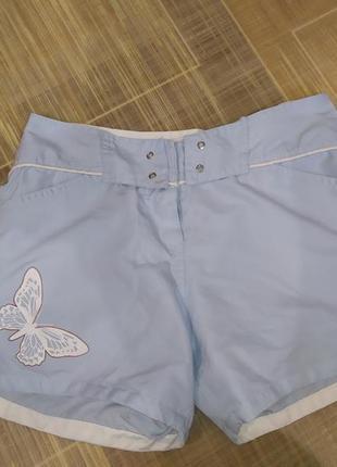 Голубые шорты с бабочкой на завязках