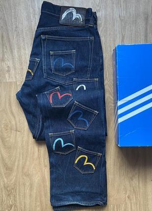 Джинсы evisu multi pocket jeans