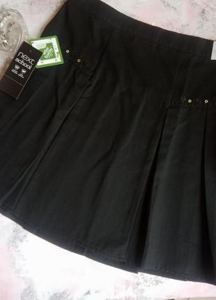 Школьная юбка на 10 лет от next из ткани, легкой в уходе