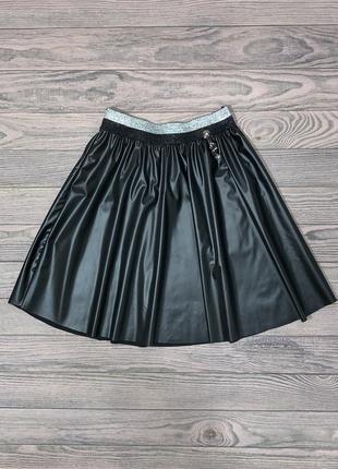 Черная юбка из эко кожи для девочки 9-13 лет.