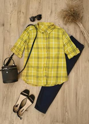 Яскрава жовта блуза в клітинку