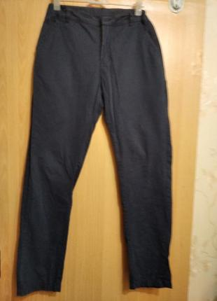 Фирменные брюки школьника темно синего цвета