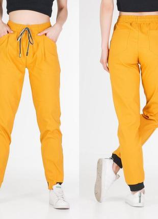 Спортивные штаны джогеры горчичного цвета