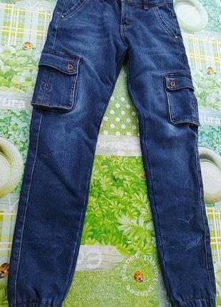 Синие джинсы на резинке внизу теплые с карманами по бокам