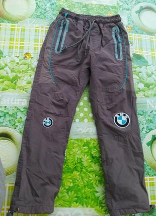 Теплые балоневые спортивные серые штаны