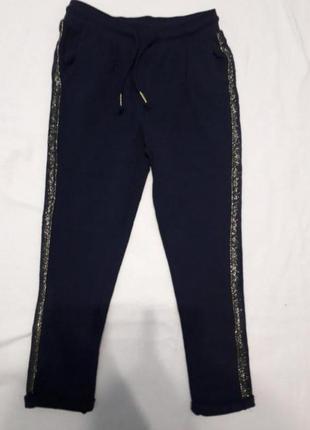 Стильні темно-сині спортивні штани  на ріст 116 см, c&a