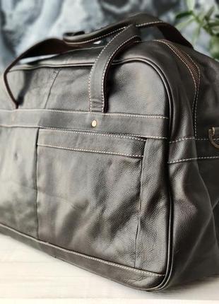 Дорожная сумка из натуральной кожи.