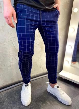 Трендовые мужские брюки в клетку