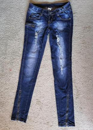 Круті джинси скінні з потертостями та змійками bonprix