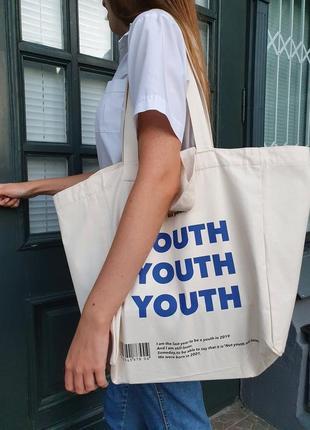 Обьемная сумка-шоппер с внутренним кармашком на магнитной застежке.