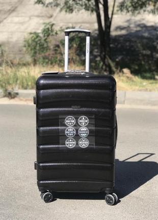 Уценка!большой чемодан из поликарбоната черный