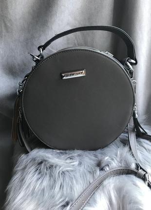 Женская круглая сумка